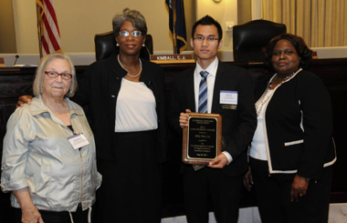 Felix Cao, J.D. '11, honored for providing pro bono legal services to the poor.